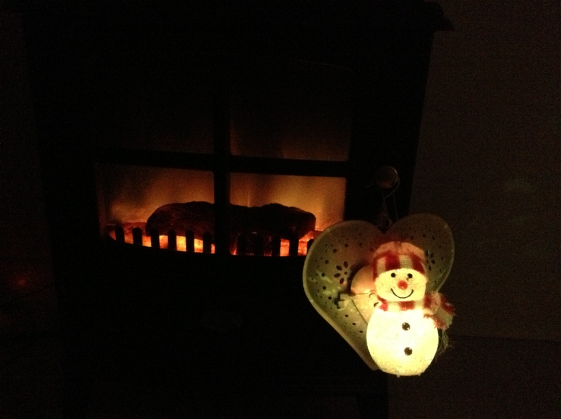 Snowman by the fire